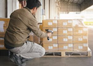 asian-warehouse-worker-scanning-bar-code-scanner-package-box-computer-tools-warehouse-inventory-management-asian-warehouse